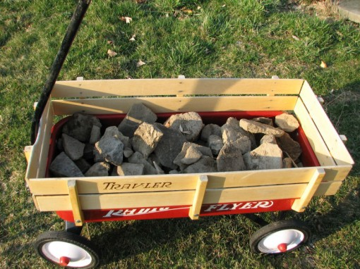 image of children's wagon full of rocks