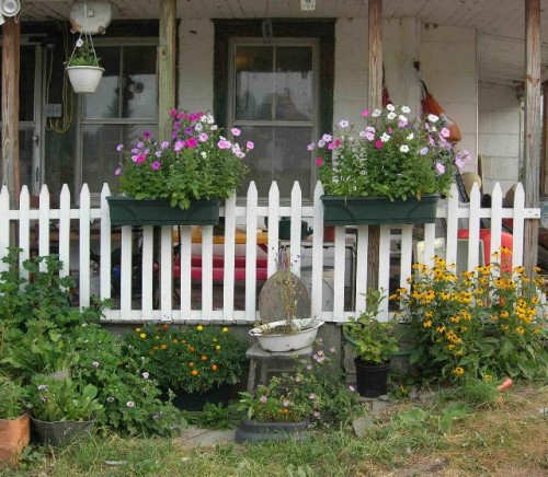 Image of porch with picket fence for a railing