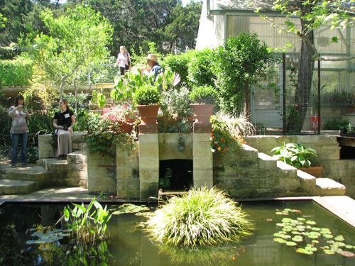 Image of formal fish pool bordered in stone