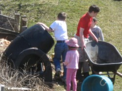Children turning the compost pile