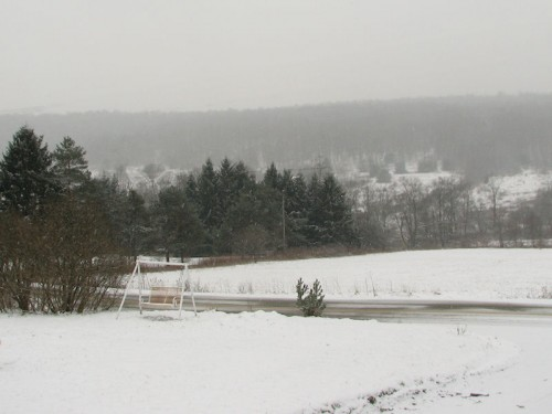 image of snowy yard and hillside