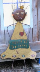 Image of metal garden ornament, figure with sign that reads never be too happy