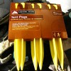 Image of a package of yellow plastic tent pegs
