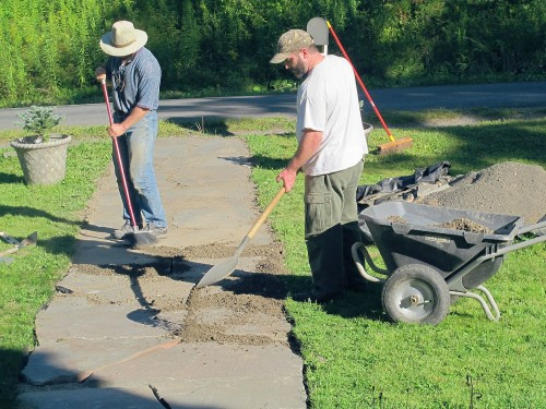 Finally, shovel the same crushed bluestone onto the walk, and sweep it into the cracks.