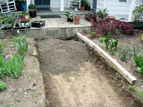 crushed stone sub-base added to trench