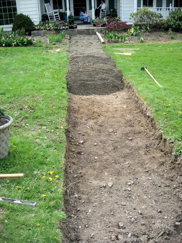crushed stone sub-base in excavated front walk