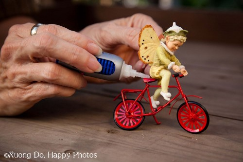 miniature fairy Boy glued on Bike