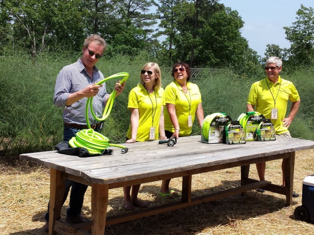 P. Allen Smith, Rachel (Weems) Perez, Mary Ann Weems, and Bob Weems put the Flexzilla hose through its paces. #g2b14