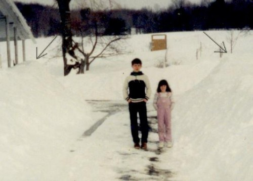Titi and Rundy standing in snow piled driveway