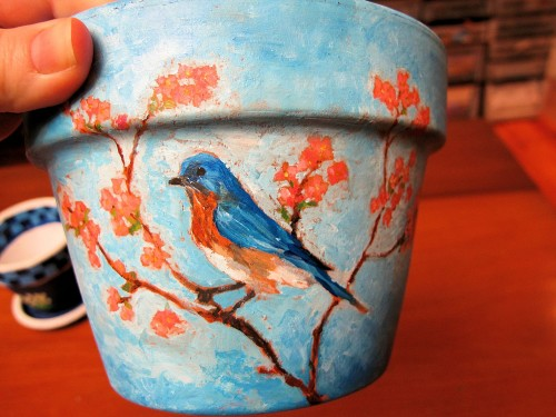 bluebird painted on clay flowerpot