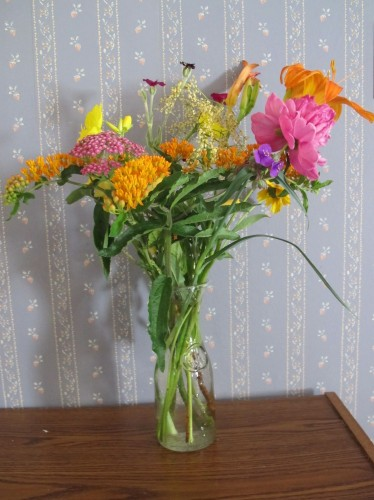 My daughter arranged these hot-colored flowers from out backyard into a pleasing bouquet.