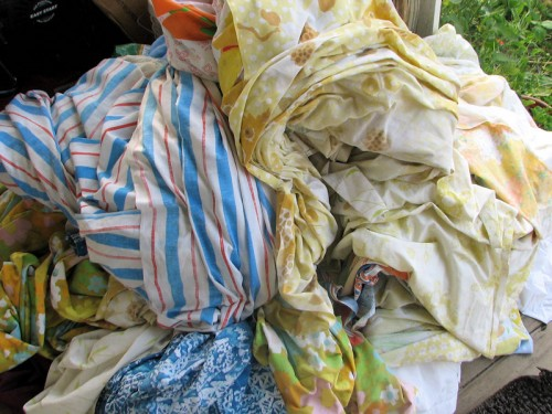 This motley assortment of sheets is stored in the attic and used to cover plants when frost threatens.