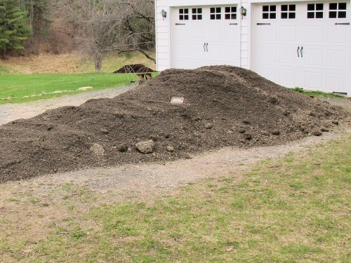 load of crushed stone in driveway