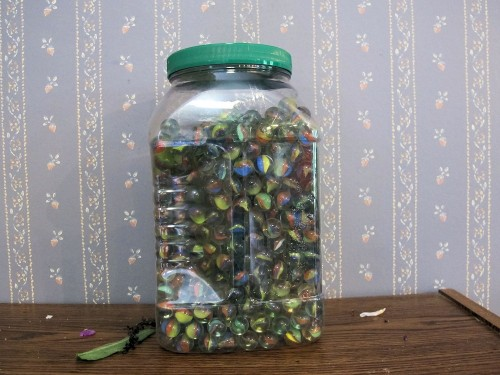 Marbles from the dollar store can be used to hold floral arrangements in place.
