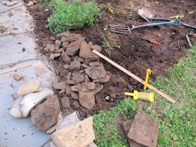 Rocks uncovered while planting a new garden bed.