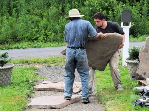 Make sure you have a way to move the stones into position when building a stone walk.