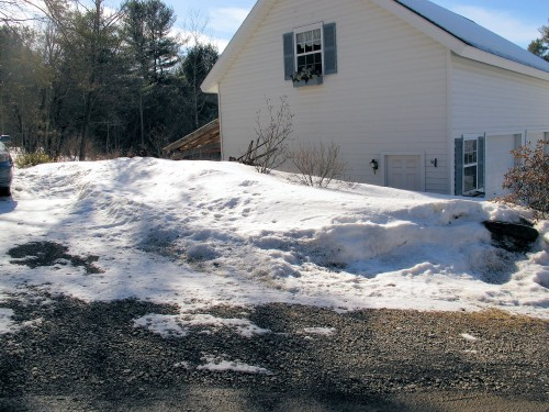 big snow pile in driveway