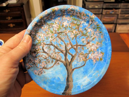 blossoming apple tree painted on a clay saucer