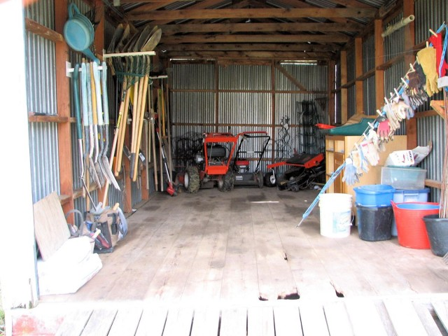 Organized shed before wheelbarrows wheeled in