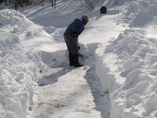 Man shoveling deep snow