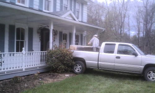 unloading a pickup truck at a house