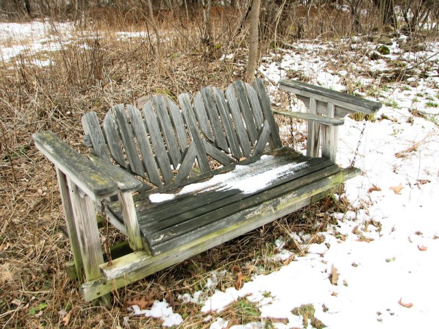 weathered Adirondack glider