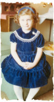 Image of young girl in blue velvet dress with lace collar